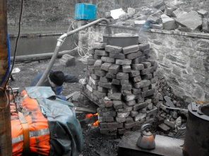 A traditional steaming boiler set up to create the steam to bend the timbers, note the kettle for a brew too!