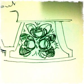 Sketch of the flower design adjacent to the spout...