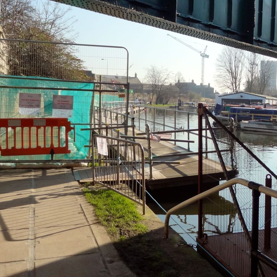 The temporary towpath rejoins the main towpath below the bridges carrying the Midland mainline out of St. Pancras...