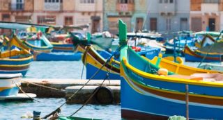 44r-gozo-colourful-painted-boats-fill-the-harbour