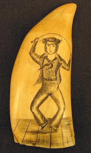 a-scrimshaw-whale-tooth-crica-1850-etched-with-a-sailor-dancing-a-hornpipe
